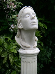 Breath-taking - life size portrait head in marble resin on stone column (close up)